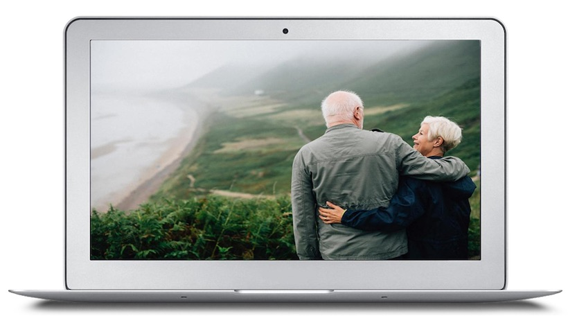 encore careers for retirees - image of an older couple gazing down on a beautiful view with arms over each others shoulders