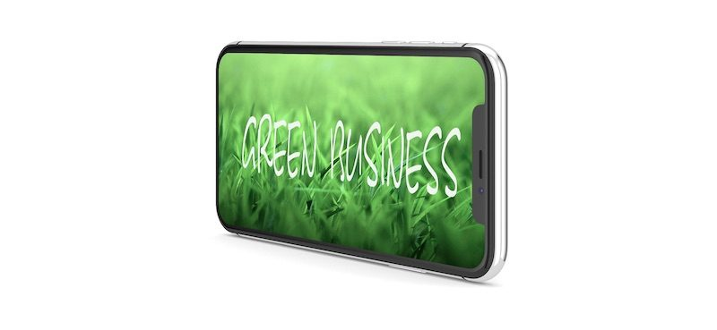 Image of an Iphone X. On screen is a picture of green grass blades. White text reads green business. Images represents best green business ideas